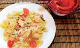Insalata di pasta con pomodorini, rucola e speck